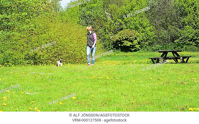 Woman walk with a pug