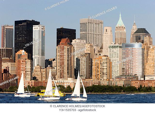 Sailboats on the Hudson River, with the lower Manhattan financial district of New York City as a backdrop, as seen from Liberty State Park, New Jersey, USA