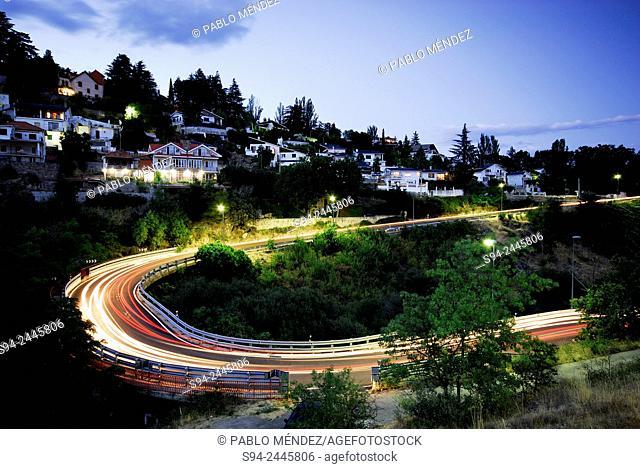 Road for exit the town in Miraflores de la Sierra, Madrid, Spain