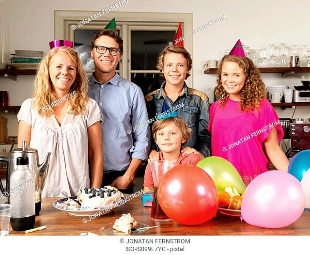Portrait of family at birthday party