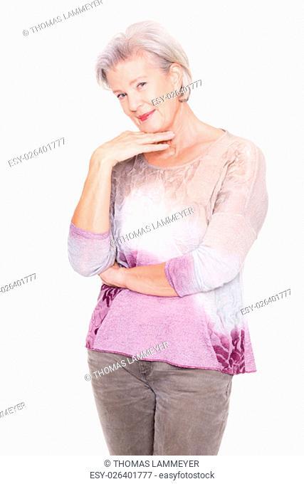 studio shot of a senior woman against white background