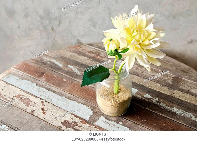 Yellow Artificial Flower decorated on wooden table