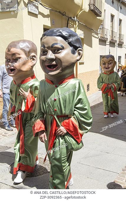 Gigantes y cabezudos parade the Corpus Christi day in Zamora