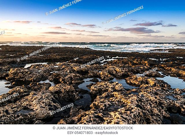 Scenic view of rocky beach at sunset, Cotillo, Fuerteventura, Canary Islands, Spain