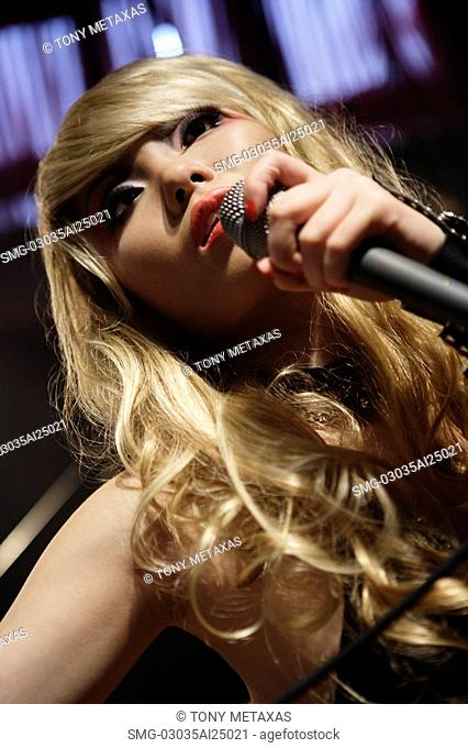 rock band woman holding microphone, singing