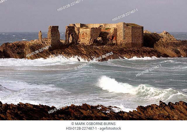 British Channel Islands. Alderney. View of coastal ruin of Victorian Fort Les Hommeaux Florains