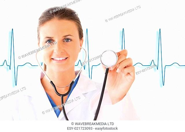 Smiling doctor holding up stethoscope on white background with blue ECG line