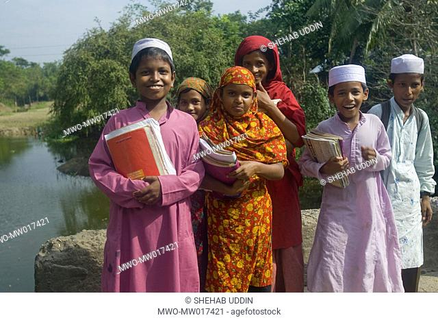 A group of children on their way back to home from a religious school or 'Madrasa', at Naria, in Shariatpur, Bangladesh November 05, 2008