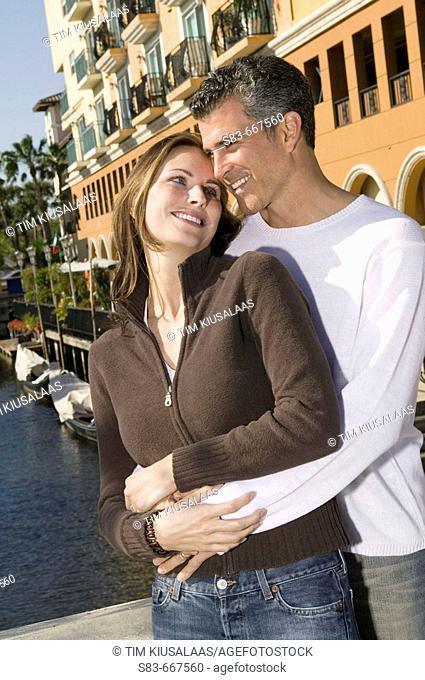 Couple embracing on bridge in Ft. Lauderdale FL