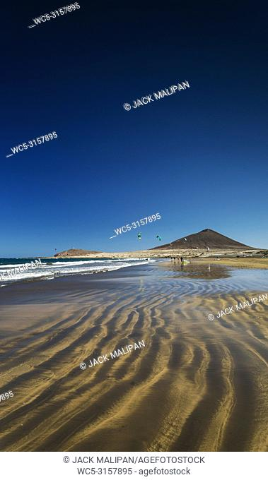 la tejita kite surfing beach and montana roja landmark in south tenerife spain
