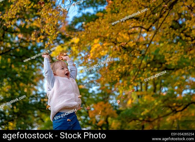 happy child with their dog enjoy play in autumn park