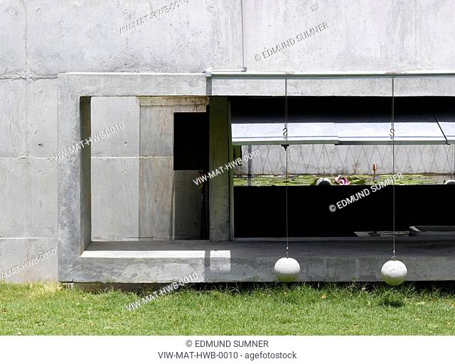 THE HOUSE WITH BALLS-SHOWING CONCRETE COUNTER WEIGHT BALLS