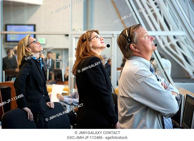 In Firing Room 4 of the Launch Control Center at NASA's Kennedy Space Center in Florida, NASA's Discovery Flow Director Stephanie Stilson, left