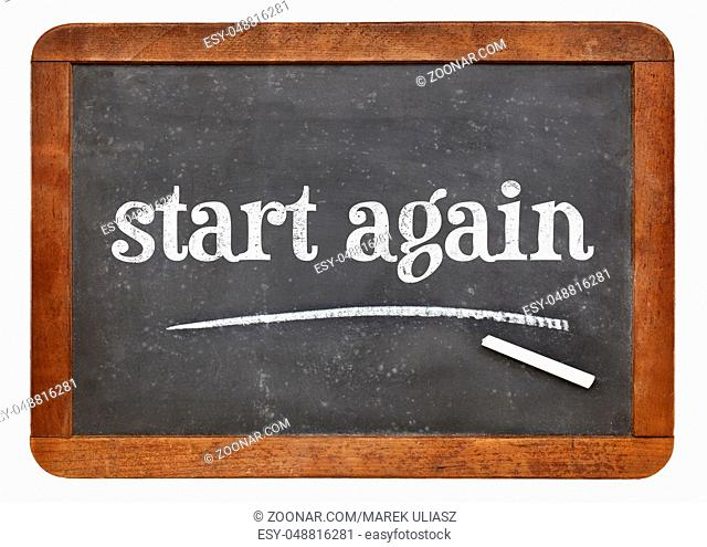 start again sign - white chalk text on a vintage slate blackboard