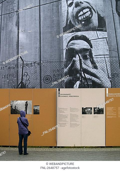 Rear view of person standing at checkpoint, Checkpoint Charlie, Berlin, Germany