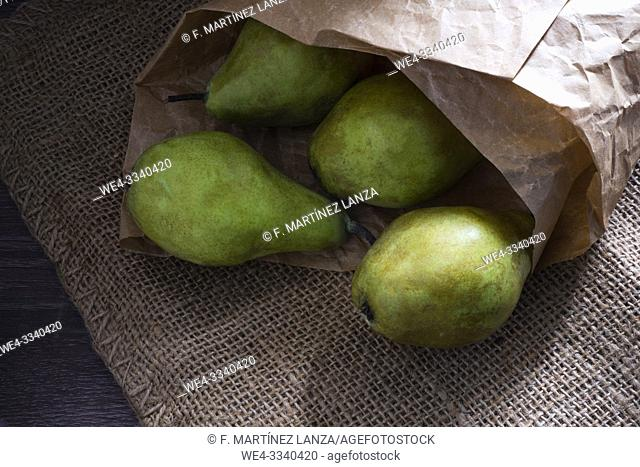 Water pears wrapped in paper