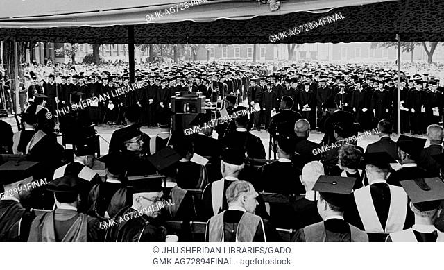 Photograph with view from Gilman Terrace of Johns Hopkins University over faculty to graduates in Keyser Quadrangle, Stewart Harding Hulse Jr