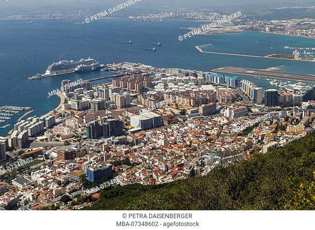 View from the Rock to Gibraltar, gem and British enclave at the Mediterranean Sea and La Línea de la Concepción, border town on the Spanish mainland