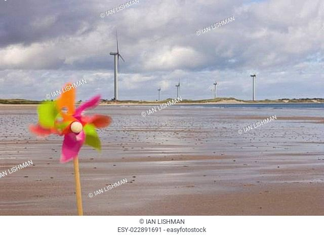 Windmills and pinwheel on shore
