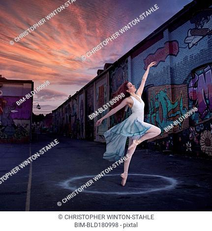 Caucasian ballerina dancing in circle