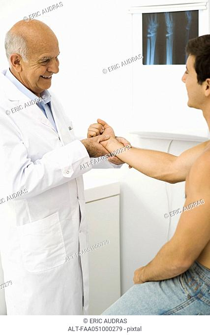 Doctor examining patient's wrist