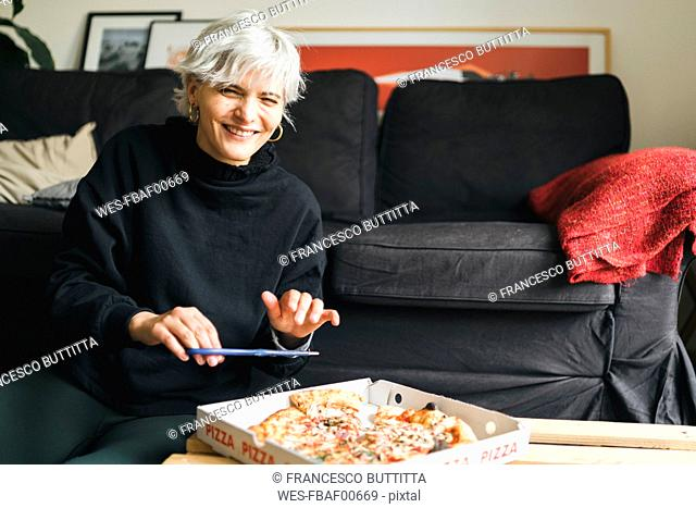 Woman eating pizza at home