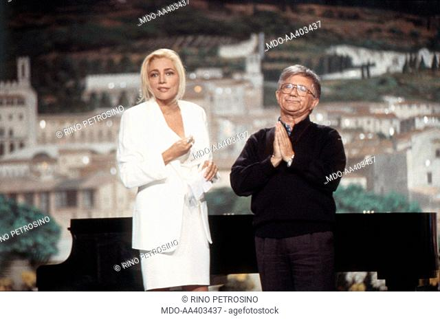 Mara Venier and Antonio Mazzi in Domenica in. Italian TV presenter and actress Mara Venier (Mara Provoleri) and Italian priest Antonio Mazzi presenting Domenica...
