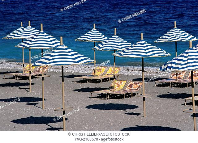 Pattern of Parasols & Sunloungers on Deserted Beach Rhodes Greece