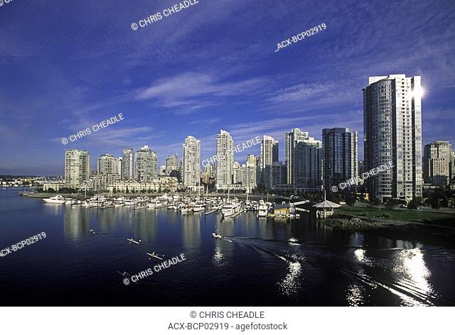 View across False Creek to condos from Cambie bridge with rowers, Vancouver, British Columbia, Canada