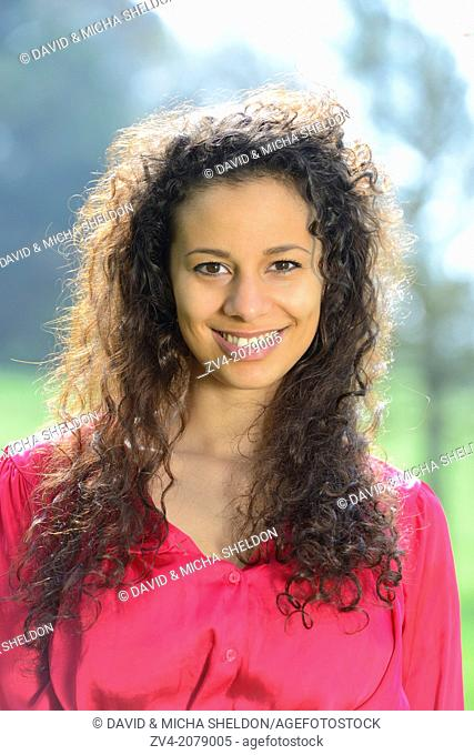 Portrait of a happy young woman outdoors, Germany
