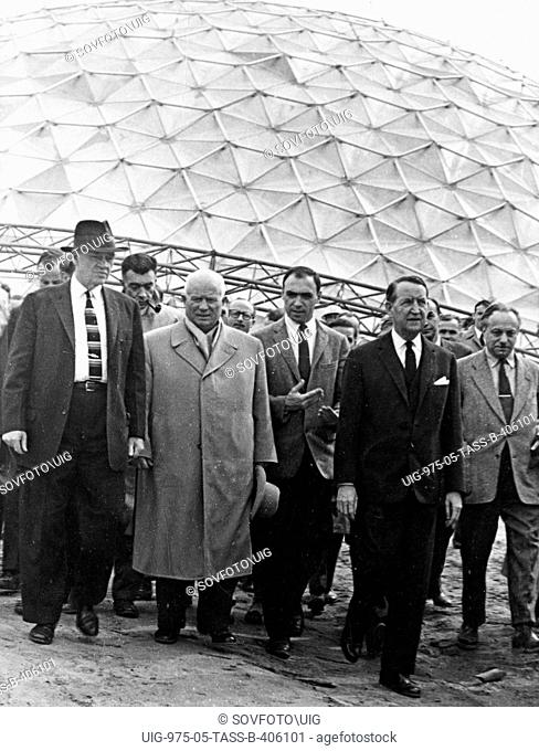 Nikita khrushchev with american ambassador l, thompson (2nd from right) visiting the building sight of the main pavillion of the american national exhibition in...