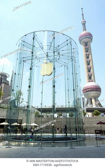 Detail of Apple store with Pearl Oriental Tower to rear in Shanghai China