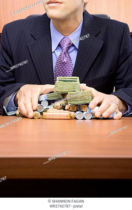 Businessman holding stack of money