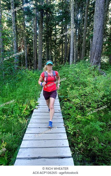 Trail running on the Rainbow Trail to Rainbow Lake, Whistler, British Columbia