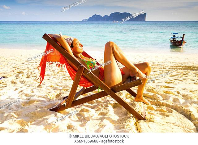 Young woman relaxing on a deckchair  Long beach  Phi Phi Don island  Krabi province, Andaman Sea, Thailand