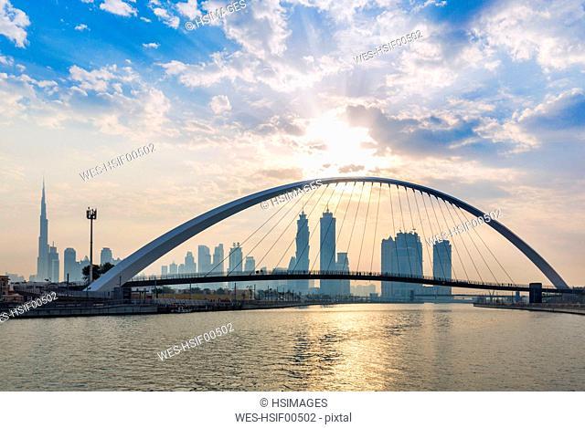 United Arab Emirates, Dubai, Dubai Creek pedestrian bridge and skyline