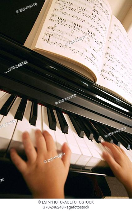 Close Up of Young Girls Hands Playing the Piano