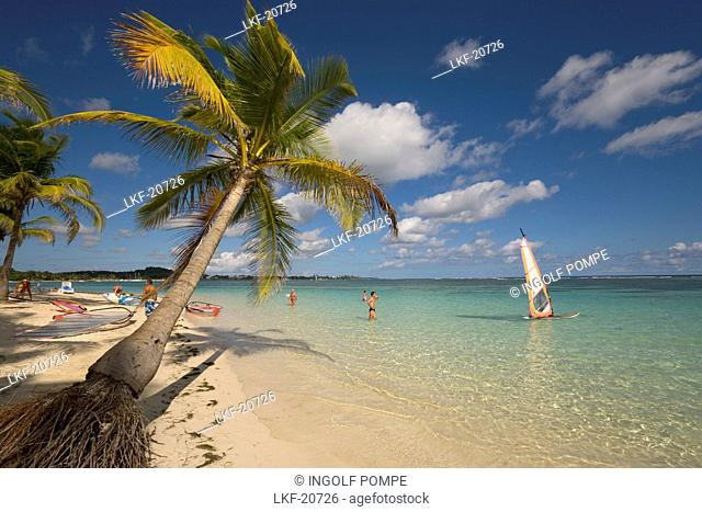 Surfer in front of Caravelle Beach, Club Med, Grande-Terre, Guadeloupe, Caribbean Sea, America
