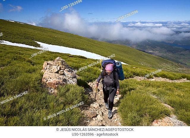 Woman practicing mountaineering in the Sierra de Béjar Natural Park, in Salamanca province, Biosphere Reserve of Sierra de Béjar and Francia