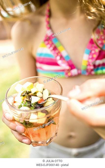 Girl with glass of homemade lemonade