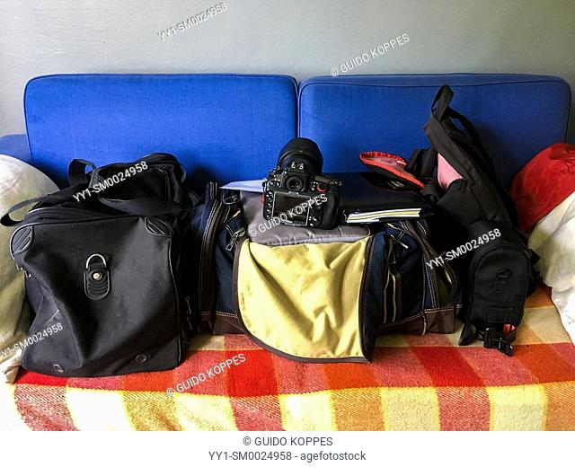 Tilburg, Netherlands. A large weekend's luggage and equipment on a couch, just prior to the Roparun 2018 job
