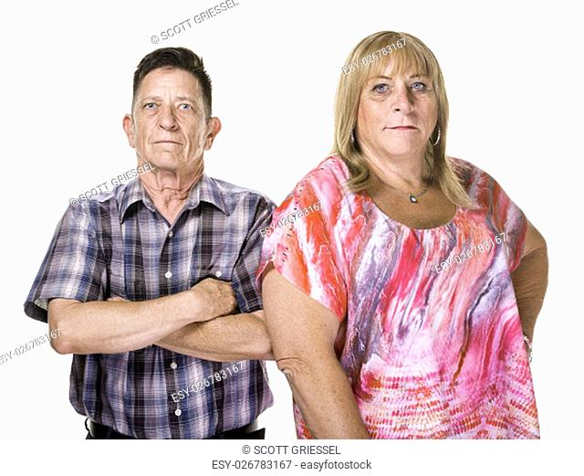 Skeptical or angry transgender man and woman isolated on white background