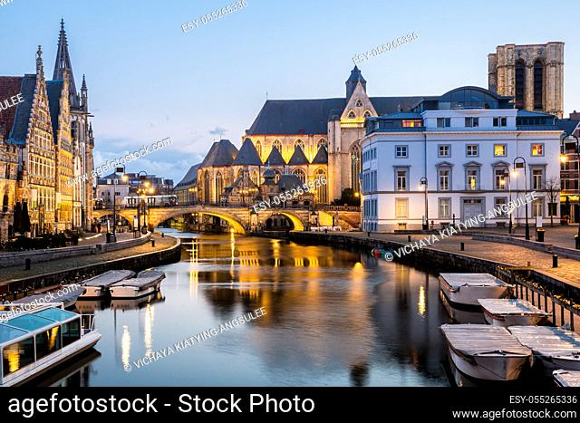 Picturesque medieval buildings on Leie river in Ghent town, Belgium at dusk