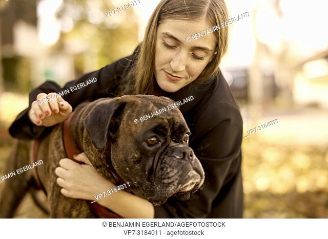 woman with dog. In Sauerlach, Munich, Bavaria, Germany