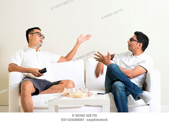 Men arguing. Two male friend disagree to each other and having argument at home. Multiracial people friendship