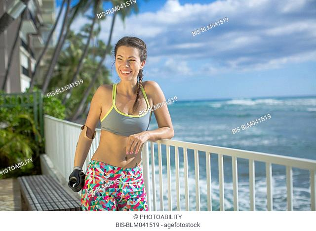 Mixed race amputee athlete smiling outdoors