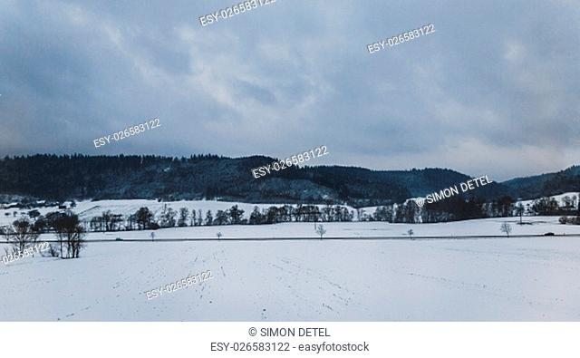 Winter mountains, panorama with snow and dark clouds