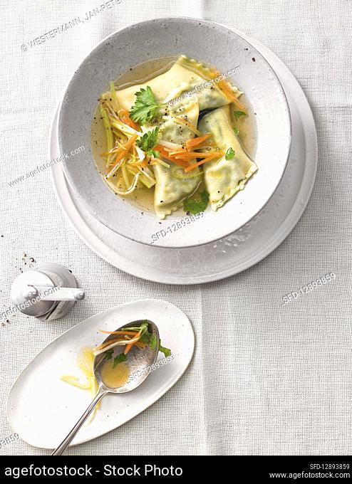 Spinach dumplings in broth