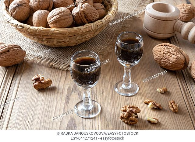 Homemade nut liqueur with walnuts on a table