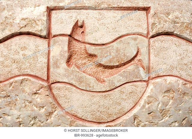 Crest of the Breitenbach municipality, trout in a stream, carved into red triassic rock, Breitenbach, Tyrol, Austria, Europe